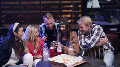 Satisfied carefree 30s mates in trendy clothes watching on phone funny photos Footage