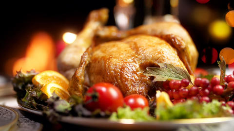Closeup slow motion video of freshly baked turkey on Christmas dining table Footage