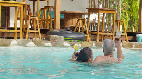 Nice Adult Couple Asking For More Drinks Enjoying The Pool Live Action