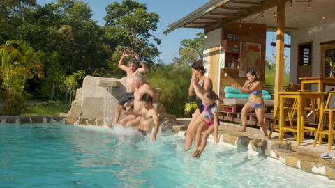 Tourists Jump Into A Pool Of A Lodge In The Ecuadorian Amazon Live Action