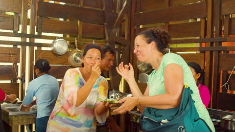 Women Tourists Tasting Freshly Made Cocoa Paste Live Action