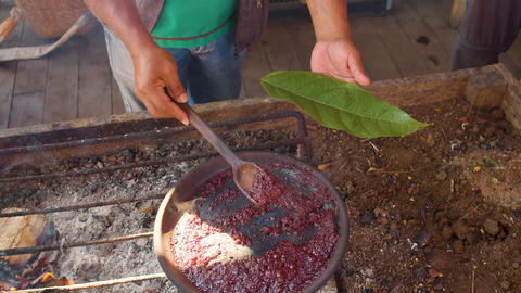 Detail Shot Of Man Serving On A Leaf Cooked Organic Cocoa Paste Footage