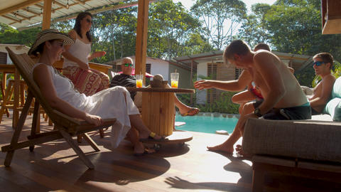 Tourists Enjoying Drinks Near A Pool In A Lodge In The Ecuadorian Amazon Live Action