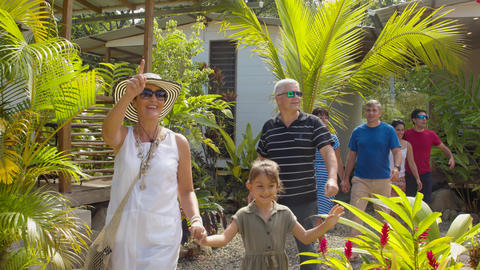 Family Of Tourists Walking And Admiring A Lodge In The Amazon Rainforest Live Action