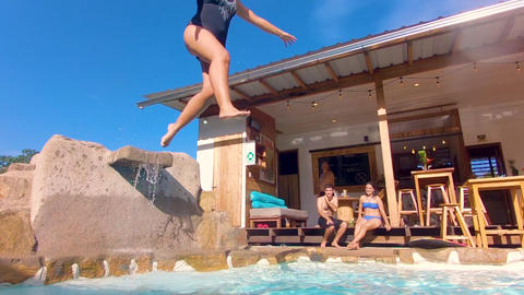 Adult Woman Jumping In A Pool Of A Lodge In The Ecuadorian Amazon Live Action