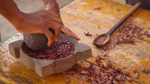 Detail Shot Of Hands Grinding Cocoa Beans With A Mortar Live Action