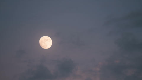 Moon with clouds in night sky Live Action