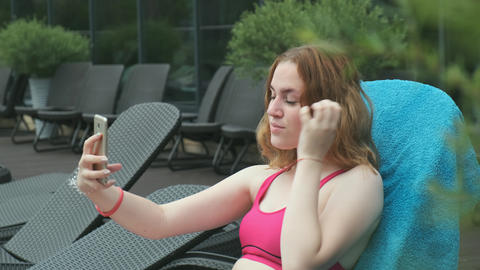 Beautiful girl takes a selfie on a smartphone Live Action