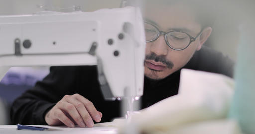 Closeup of designer stitching with an industrial sewing machine Footage