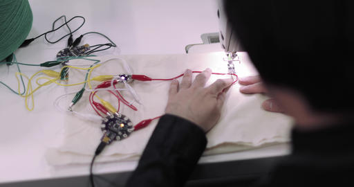 Designer working on wearable technology idea, Live Action