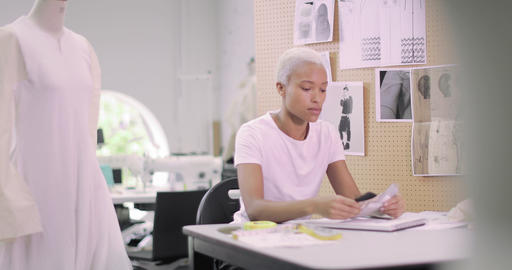 Fashion designer selecting fabrics for designs Footage