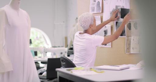 Fashion designer selecting fabrics for designs, Live Action