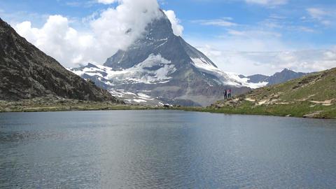 Scenic view on snowy Matterhorn peak and lake Stellisee, Zermatt, Switzerland Live Action