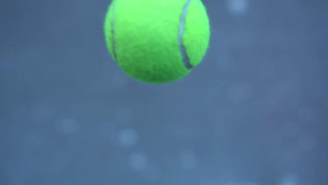 Video of a tennis ball flying. The main object of the ball is out of focus Live Action