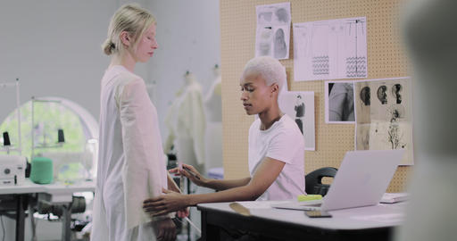 Fashion designer working on design with a model Live Action