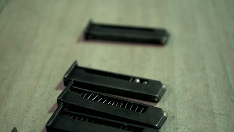 cartridges and gun clips are on the table Live Action