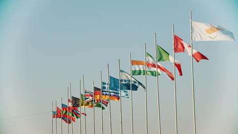 Flags of the world countries blowing in the wind on the background of clear Footage