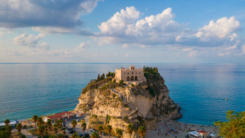 Timelapse with sea, clouds and view on rock mountain with the Sanctuary of Santa Maria dell'Isola. GIF