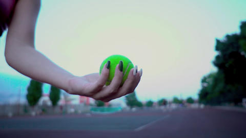 Girl plays tennis. Hand girl throws the ball into the air, and then catches Live Action