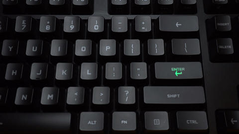 Key blinks Enter on glowing computer keyboard Live Action