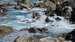 Waves crashing on rocks as tide comes in Footage