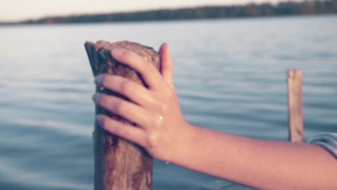 Hand on Wooden Jetty Pole Focus Pull Summertime - Cinematic Look Footage