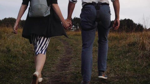a guy and a girl holding hands GIF