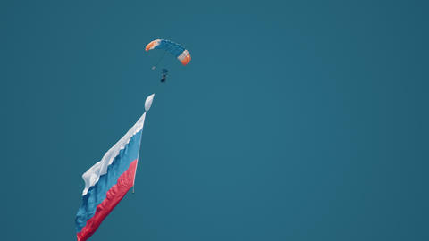 30 AUGUST 2019 MOSCOW, RUSSIA: A man parachutist flying up in the air with Footage