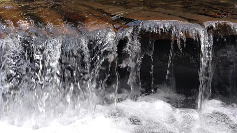 Wooden structure artificial waterfall under the man-made bridge Channel concept Falling waterfall Live Action