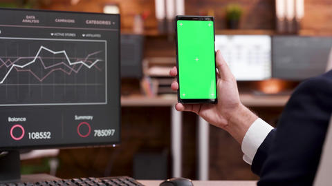 Back view of businessman working on mobile phone with green screen ライブ動画