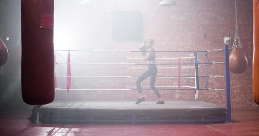 Young adult female boxer shadowboxing Live Action
