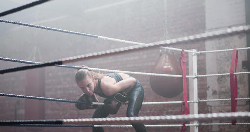 Young adult female boxer stepping into the ring Live Action