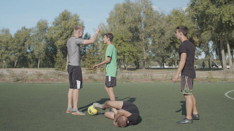 Soccer referee showing red card to player Live Action