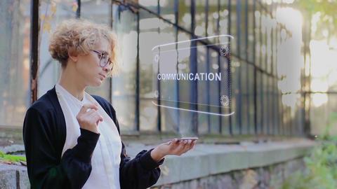 Blonde uses hologram Communication Footage