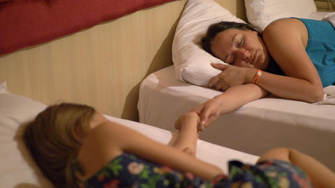 Calm beautiful young women holding hands and sleeping in hotel room Footage
