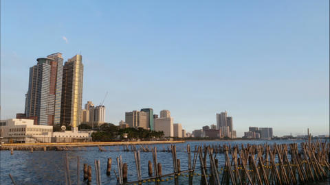 Manila skyline seen from the pier, time lapse from day time to night Live Action