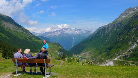 People enjoy the breathtaking view over the Swiss Alps - SWISS ALPS, SWITZERLAND Live Action