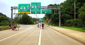 People and Bikers Use the Middle of the Street in Pittsburgh During Open Streets Footage