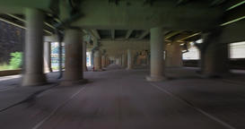 Fast Blurred Motion Driving Through Cement Parking Structure in City Footage