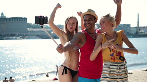 Group of smiling friends making selfie on beach Footage