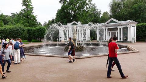 POV walk to Eva fountain, slow motion, tourists stroll around Footage