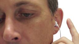 Male Earbud Speaker Closeup Isolated on White Footage