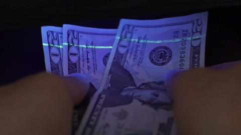 Twenty Dollar USA Money Blacklight Counterfeit Check Closeup Footage