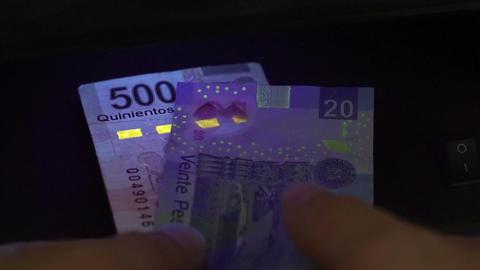 Mexico Pesos Blacklight Counterfeit Check Closeup Footage