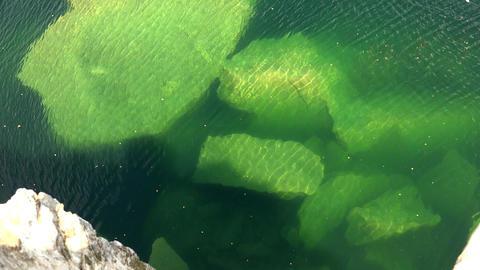 Large stones under water. 4K Footage