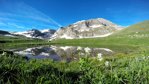 The picturesque lake at the foot of the mountain Oshten. The Caucasian mountains Live Action