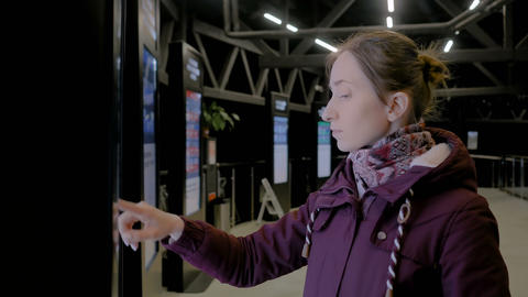 Woman using interactive touchscreen display of electronic multimedia kiosk Footage