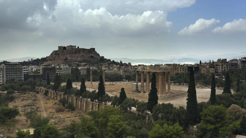 Low altitude aerial shot of the Temple of Olympian Zeus and famous Acropolis in Footage