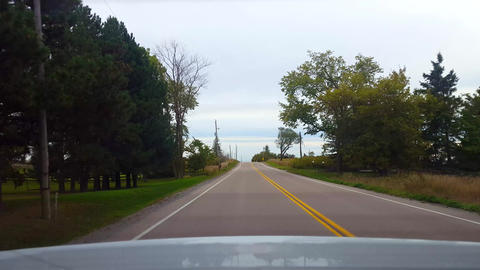 Rear View From Back of Car Driving Rural Countryside Road Under Overcast Day. Car Point of View POV Live Action
