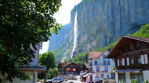 Giant waterfall in the Swiss Alps - SWISS ALPS, SWITZERLAND - JULY 20, 2019 Live Action